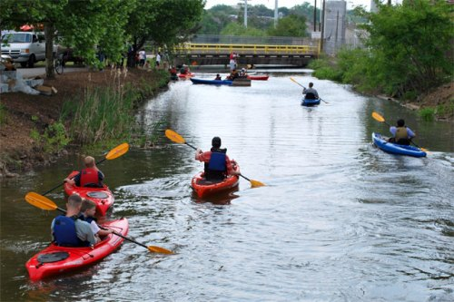 Paddlers in the Manchester Canal during the 2010 Earth Day Festival