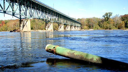 A drainage pipe from Boulevard Bridge resting on the southbank of the James River