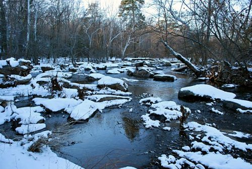 Snowy boulders in the James River near Archer Island
