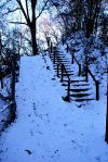 Snow-covered staircase and bike ramp on the Buttermilk Trail