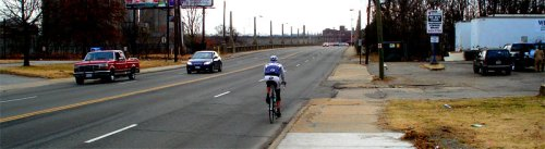 Biker riding along Mayo Bridge in downtown Richmond