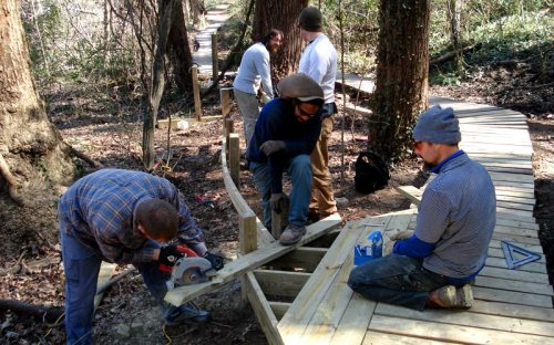 James River Park staffers work on the Buttermilk Trail boardwalk on March 4