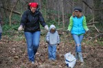 Loni Eddy and her children Noah and Grace plant wildflower seeds at Reedy Creek