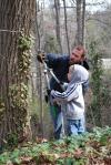 Joel Eddy and his son Noah cut English ivy at Reedy Creek