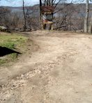 The eroded slope down to the access tower. The plan is mulch in the area and halt the erosion.