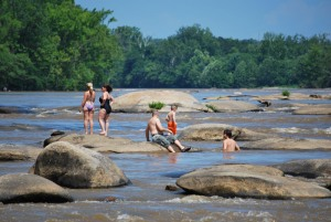 Granite boulders of Pony Pasture bring many people to play and sunbathe